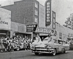 Parade passing in front of the Brunson Theater, 1956