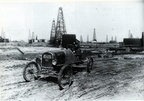 An unidentified man with his car in the middle of the Goose Creek oil field